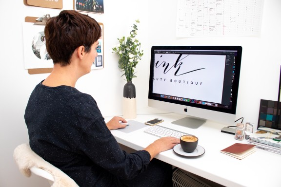 woman designing a logo on the computer